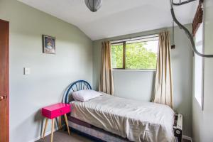 Ένα ή περισσότερα κρεβάτια σε δωμάτιο στο Lovely Family Home