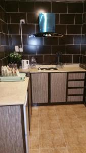 A kitchen or kitchenette at Burj Al Balad Hotel Apartments