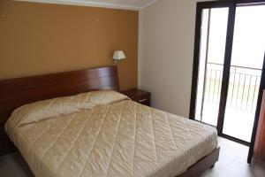 A bed or beds in a room at Case Vacanze Bellavista