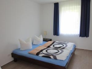 Ein Bett oder Betten in einem Zimmer der Unterkunft Ferienwohnung zum Breitling