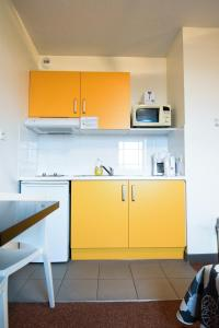 A kitchen or kitchenette at Residhotel Lyon Lamartine