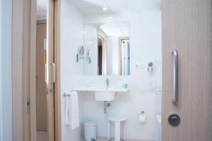 Ванная комната в Aparthotel Acualandia