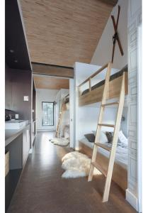 A bunk bed or bunk beds in a room at Euroshack