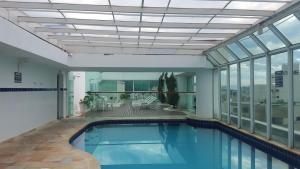 The swimming pool at or near Flat Guarujá Four Seasons