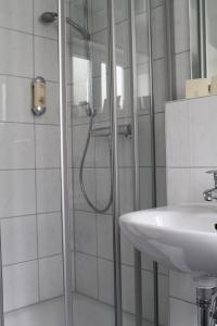 Ein Badezimmer in der Unterkunft GGAppartements