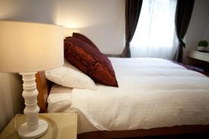 Letto o letti in una camera di Welcome Inn Victoria