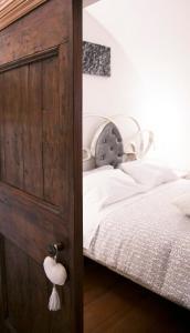 Letto o letti in una camera di Antica Dimora Julia
