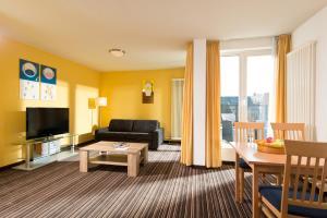 Гостиная зона в HSH Hotel Apartments Mitte