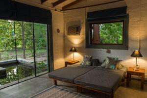 Ein Bett oder Betten in einem Zimmer der Unterkunft Neem Tree House