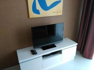 A television and/or entertainment center at Paradise Park By Glen