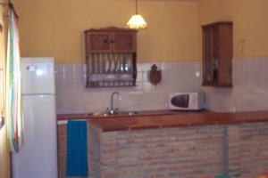 A kitchen or kitchenette at Casa Rural Victor