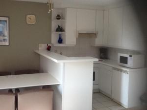 Een keuken of kitchenette bij Morgenzon Apartment