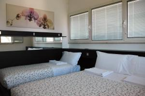 A bed or beds in a room at Il Terrazzo
