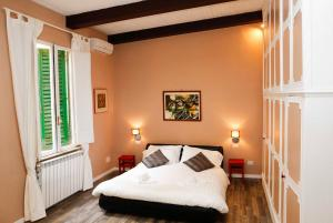 A bed or beds in a room at Rome in Apartment - Navona Pantheon