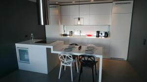 A kitchen or kitchenette at Athina Art Apartments