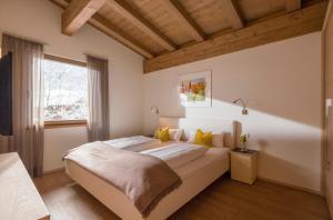 Ein Bett oder Betten in einem Zimmer der Unterkunft Resort Tirol am Wildenbach
