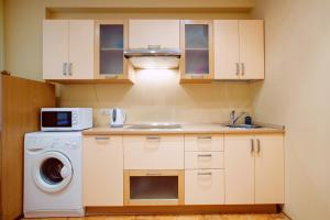 A kitchen or kitchenette at Moscow For You Arbat Apartments