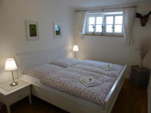 Ein Bett oder Betten in einem Zimmer der Unterkunft Apartment Schreyegg