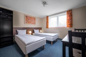 Łóżko lub łóżka w pokoju w obiekcie Gim Apartments