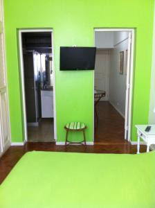 A television and/or entertainment center at Heart of Copacabana: 1 Min. from Beach