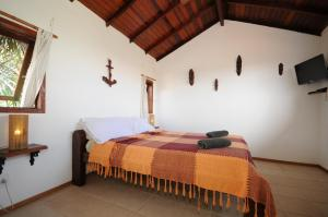 A bed or beds in a room at Búzios Casa 3