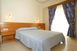 A bed or beds in a room at Sagittarius Apartments