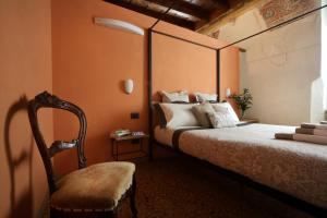 Letto o letti in una camera di Residenza Roccamaggiore
