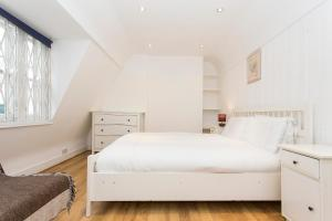 A bed or beds in a room at London Dream House - Historic Soho House