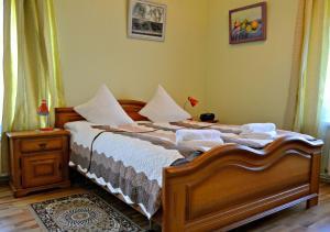 Uma cama ou camas num quarto em Jasmine Apartamenti