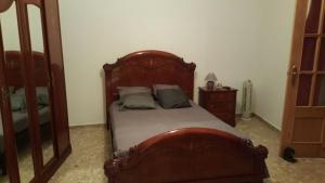 A bed or beds in a room at Casa Trini