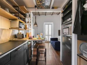 Majoituspaikan Over The Tiber Loft keittiö tai keittotila