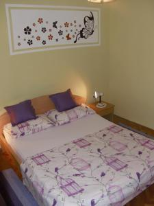 A bed or beds in a room at Apartments Pavlić