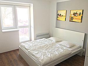 Postel nebo postele na pokoji v ubytování Apartmány Jakub - Lipno nad Vltavou