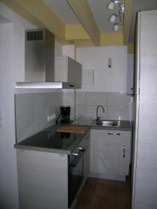 Cuisine ou kitchenette dans l'établissement Ti Gwen