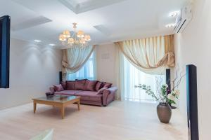 A seating area at Vip Apartment In Minsk