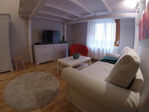 Ein Bett oder Betten in einem Zimmer der Unterkunft RumbArt Apartman
