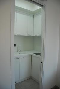 A kitchen or kitchenette at LHP Suite Rapallo