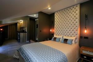 Letto o letti in una camera di Charm Flats