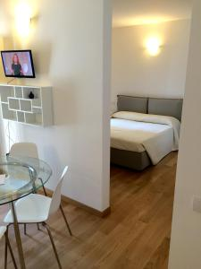 A bed or beds in a room at Central Station Milano Suites & Apartments