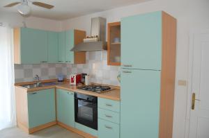 A kitchen or kitchenette at Appartamento San Feliciano
