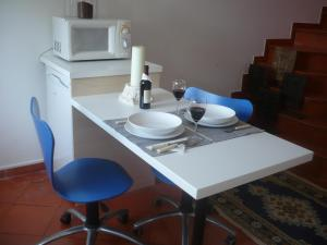 A kitchen or kitchenette at Morada Do Sol