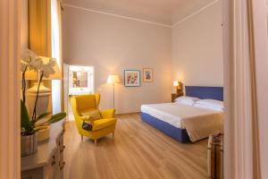 Een bed of bedden in een kamer bij Palazzo Alfani - Residenza d'Epoca