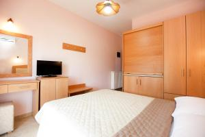 A bed or beds in a room at Asteras Kalives