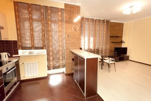 A kitchen or kitchenette at Apartment Grand Kazan near Kremlin