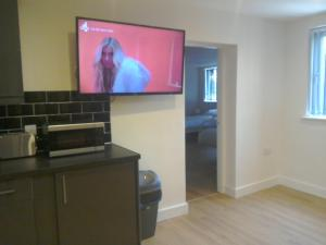 A television and/or entertainment center at The Dorchester Serviced Apartments