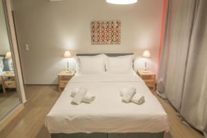 A bed or beds in a room at Petra Luxury Apartments