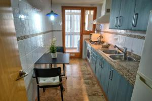 A kitchen or kitchenette at Alicia Apartment by Hello Apartments Sitges