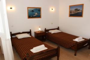 Ένα ή περισσότερα κρεβάτια σε δωμάτιο στο Σωτηρία