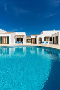 The swimming pool at or near Casas Menorquinas