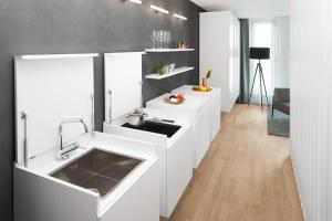A kitchen or kitchenette at AMANO Home